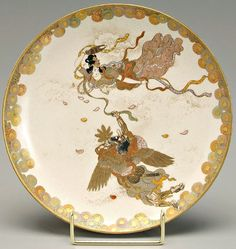 Satsuma pottery aerial pursuit of a Tenshi (Angel) by a Tengu (Crow Demon), border of chrysanthemums.  Base with gold Kinkozan mark.