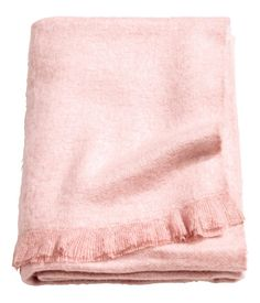 Dusky pink. Throw in soft, woven melange fabric with fringe on short sides.