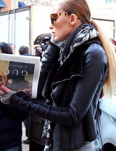 Great sunglasses. Good leather jacket (Gucci?) Looks like Olivia Palermo.