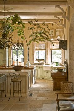 What? this looks it should be on a Southern Home, but somehow, it's Pretty.......... barry dixon kitchen. floor.