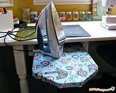 DIY: Slide out Ironing Board.  I usually just use a heat mat, but this is a cute idea for the Sewing Studio.