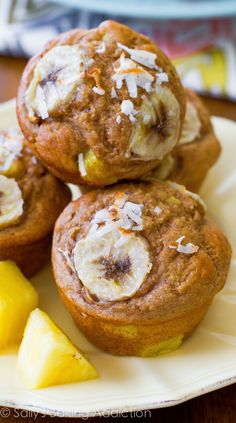Easy, moist, low-fat tropical muffins! Made with bananas, whole wheat flour, pineapple, orange zest, yogurt, and coconut.