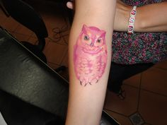 I'm really getting burned out on owl tattoos, but this one is neat. I like that it's nearly all one color of ink