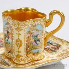 Jeweled Coalport Porcelain Demitasse Cup and Saucer, England, late 19th century, quatrefoil-shaped cup with square saucer, each with ivory ground decorated with raised gold scrolled foliage bordering white jewel framed cartouches polychrome enamel-decorated with birds, printed crown mark, saucer dia. 4 7/8 in.