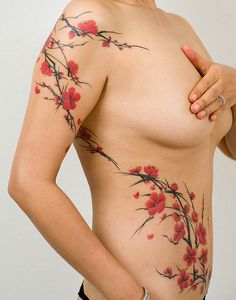 cherry blossom side tattoo that's gorgeous and delicate