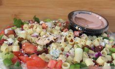 Chopped Salad: Chopped Crispy Iceberg & Romaine Lettuce, Chopped Chicken, Gorgonzola Cheese, Ditalini Pasta, Tomato, Red Cabbage, Green Onions, Bacon & Sweet Red Wine Vinaigrette.