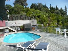 Waimanu Lodge Northland New Zealand. Guest deck with swimming pool, BBQ, Spa Pool and garden Harbor View, New Zealand, Swimming Pools, Bbq, Deck, Studio, Luxury, Reading, Garden