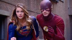 Grant Gustin, Melissa Benoist On Filming 'The Flash,' 'Supergirl' Musical Crossover |