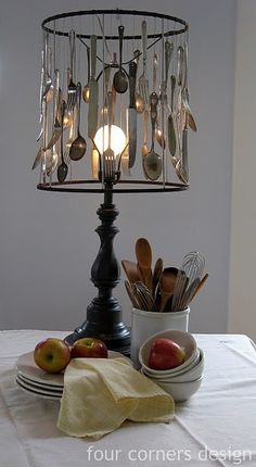 `Vintage, quirky and very now . . . use old cutlery to line the rim of a lampshade base.  Drill a small hole in the handle and thread wire through and onto the shade base to secure in place.