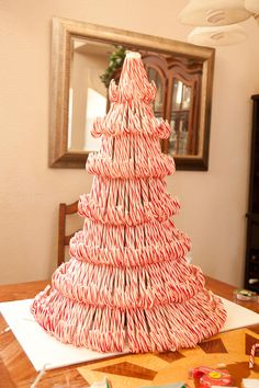 Candy Cane Xmas Tree http://amenphotography.com/blog/2010/12/our-candy-cane-christmas-tree-project/