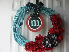 Spray painted grapevine wreath with initial I think i would put a wooden letter instead with a bigger bow !
