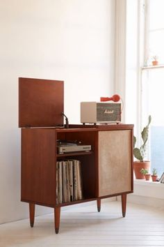 Draper Media Console - Urban Outfitters-  DIY this. Speaker screen slides.