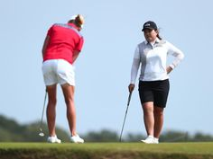 Inbee Park of South Korea watches Stacy Lewis of the