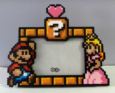 Just when I thought the 8-bit Perler beed thing was tired. DIY picture frame.
