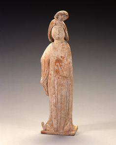 Chinese   Standing Female Figure, Tang dynasty (618–907), 7th–8th century  Earthenware with slip-painted decoration  height: 15 in.