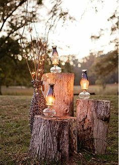"""Don't forget the little touches! These tree stumps make perfect """"tables"""" to display lanterns."""