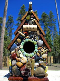 Fathers Day Birdhouse with Recycled Bullet Shell Casings, Wood Rounds and more. $85.00, via Etsy.