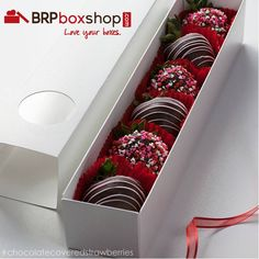 Chocolate covered strawberries in @BRP Box Shop macaron boxes.