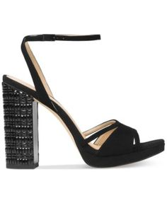 MICHAEL Michael Kors Yoonie Platform Dress Sandals $150.00 Multifaceted stones add depth and shimmering dimension to the bold platform heel on MICHAEL Michael Kors' Yoonie sandals finished in a delicate ankle strap.