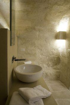 Corte San Pietro Hotel / Daniela Amoroso las paredes como impresion de algo romano