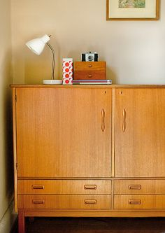 Danish modern.  My mom has lots.  Hated it as a kid.  Adore it now!!