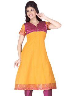 A sunny yellow #chanderi #silk #Anarkali #Kurta with a bright magenta zari border. The magenta pink #brocade #yoke enhances the look. #DesignsByKavitaS #LifestyleRetail
