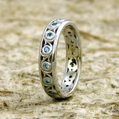 Blue Topaz Swirly Wedding Band in 14K by AdziasJewelryAtelier, $630.00