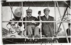 """TEDDY'S FIRST FLIGHT WITH HOXSEY."""" President Theodore Roosevelt (left) and pilot Arch Hoxsey (right) seated in Hoxsey's Wright (Co) Type AB (head on view, close-up) prior to making a flight at Kinloch Field, St. Louis, Missouri, October 11, 1910; this was the first flight of an American president."""
