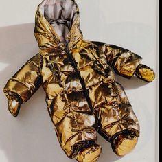 Burberry gold metallic baby snowsuit.