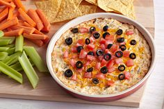Want to make any fiesta even more festive? This cheesy baked dip is made with chicken tossed in hot sauce—then topped with tomatoes and olives.