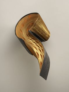 Sleek Sculpture Combines Metal With Pressed Book Pages