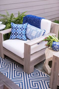 Lauren Lefevre styles her patio with Frontgate's St. Kitts Lounge Chair with Cushions.
