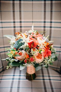Orange Wedding Bouquet   Sottero and Midgley Bridal Gown   Festival Wedding   Tipi Reception   Teal & Burnt Orange Colour Scheme   Marianne Chua Photography   http://www.rockmywedding.co.uk/nina-dave/
