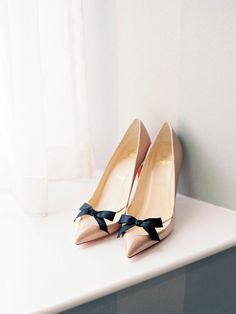 Nude #ChristianLouboutin pumps with a little black bow.  Photo: Polly Alexandre