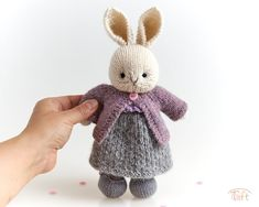 Amigurumi teddy bear toy Charlotte a knitted stuffed plush bunny animal with clothes Teddy bunny Charlotte is a knitted stuffed animal with a set of clothes. She is about 11 inches (28 cm) tall from toes to the tips of the ears. Teddy Bear Toys, Bunny Plush, Plush Animals, Cute Bunny, Wool Yarn, Ears, Charlotte, Handmade, Clothes