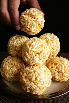 Pori Urundai is a traditional South Indian sweet made with puffed rice, jaggery and flavored with cardamom, ginger powders. Rice Puff Recipes, Rice Recipes For Dinner, Sweet Recipes, Snack Recipes, Cooking Recipes, Indian Dessert Recipes, Indian Snacks, Indian Recipes, Sweet Crepes Recipe