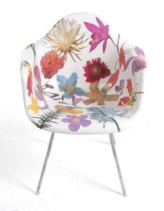 Fabulous Furnishings. Phillip Estlund's  Genus Custom Bloom Chair.  A Herman Miller Eames molded fiberglass chair with cut out images of flowers adhered to it.