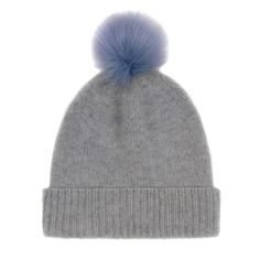 Helen Moore Bobble Hat in Grey with Cornflower Blue Pom Pom: The wonderfully soft grey cashmere beanie contrasts beautifully with the fluffy faux fur pom-pom. Made in Scotland from 100% cashmere, this gorgeous beanie is so soft and warm, and the giant pom-pom is perfect for this season.
