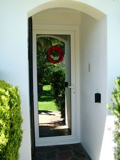 Recessed entrance door reflecting the garden. Entrance Doors, Different Styles, Building, Garden, Entry Doors, Entrance Gates, Garten, Front Doors, Buildings