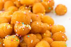 """Strufoli (or """"struffoli,"""" as it's often spelled) is a classic dish that hails from Naples, Italy, consisting of marble-sized bits of fried dough, coated in sweet honey and tossed with colorful sprinkl (Italian Dessert Recipes) Spring Desserts, Just Desserts, Delicious Desserts, Yummy Food, Italian Desserts, Italian Recipes, Italian Donuts, Italian Pastries, Italian Cookies"""