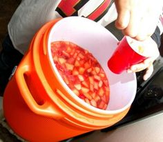 Firefighters jungle juice  1 bottle of vodka  1 bottle of tequila  1 bottle of Everclear  1 bottle of JD whiskey 1 Jar of 120 proof moonshine. Fruit, like 3 oranges, and a bundle of grapes (or any fruit you like).  2 cans of pineapple juice.  2 frozen cans of minute maid fruit punch.  2 frozen cans of minute maid limeade.  1 frozen can of apple juice.  1 frozen can of orange juice. & a bag of ice!   It is probably the best thing ever! Poor in an ice chest or a trash can(new/clean ofcourse)…
