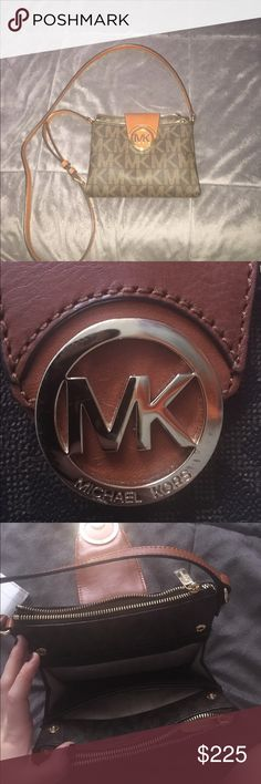 MICHEAL KORS crossbody This is an authentic brown and tan adjustable strap crossbody! Only worn once❤️ in very well shape! Perfect for any season and any occasion, you can wear it with just about anything ! Michael Kors Bags Crossbody Bags
