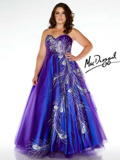 Strapless peacock feather prom gown in a shimmering purple fabric.  Prom dress has empire waist, lace up back and full skirt for a flattering fit.