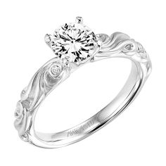With a small diamond. Love the unique band with tiny diamonds.....Engagement Rings Minneapolis | Scheherazade Jewelers