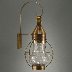 Northeast Lantern Onion 1 Light Outdoor Wall Lantern Finish: Raw Brass, Shade Type: Clear
