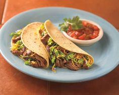 Slow-cooker Pot Roast Tacos | Slow-cooker Pot Roast Tacos Recipe - Add some Tex Mex flair to your next meal. Our pot roast tastes great flavored with taco seasoning. #Schwans #EasyRecipes #Inspiration