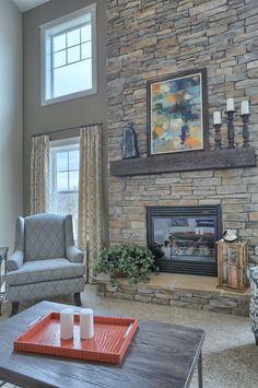 Beautiful 2-story stone surround fireplace. #ownalandmark #projectdreamhouse