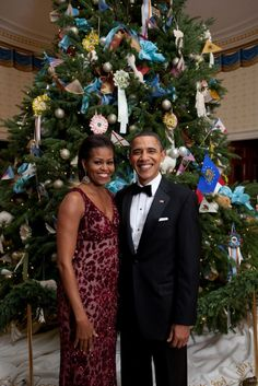 Barack and Michelle Obama Pose in Front of the White House Christmas Tree 12/2010