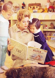 Princess Grace of Monaco, reading to Princess Caroline and Prince Albert.  (Beautiful toys in the background!)