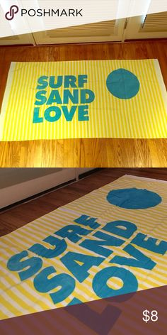 5 foot Long Beach Towel. SURF, SAND, LOVE. Never used Long Beach Towel. Yellow, white and blue. Cute and colorful. Sisters of Los Angeles Accessories